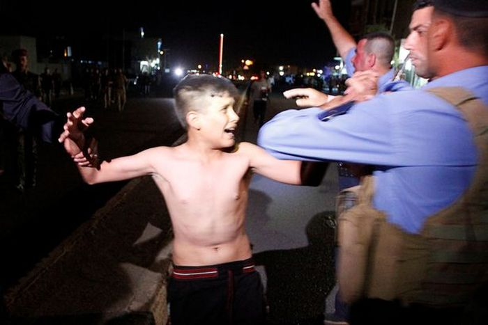Police Remove Suicide Vest From Distressed Young Boy In Iraq (5 pics)
