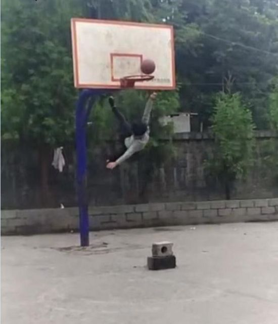 Unsuccessful Basketball Jump Goes From Bad To Worse (5 pics)