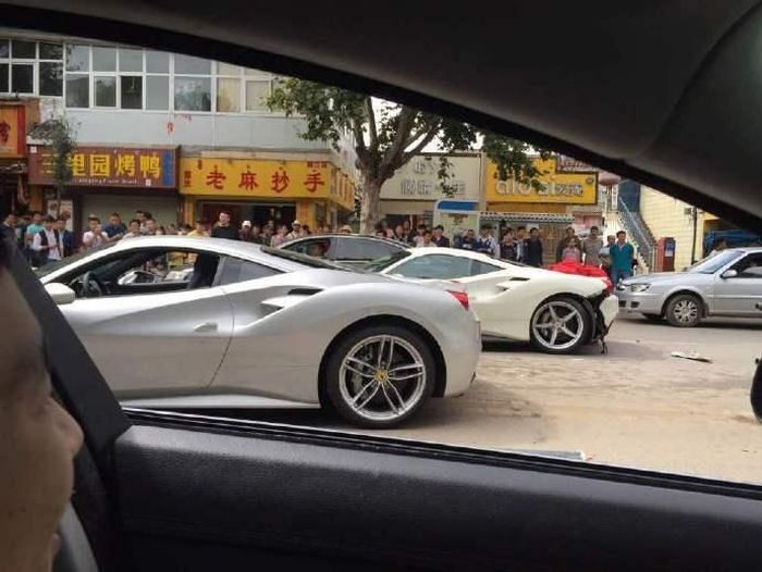 Two Ferraris Collide After A Dog Runs Into The Road (10 pics)