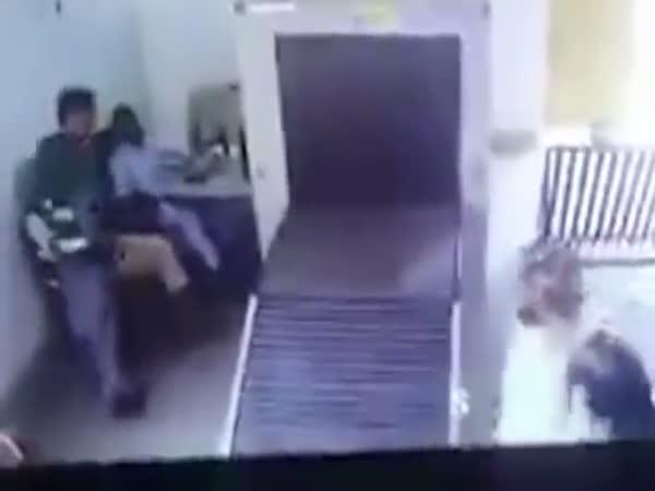 Confused Traveller Rides Conveyor Belt Through A Baggage Scanner