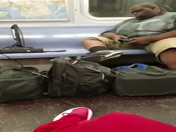Man Plays Xbox 360 On NYC Subway