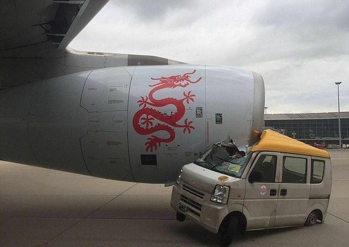 Hong Kong Plane Crushes Service Van On Airport Runway (4 pics)