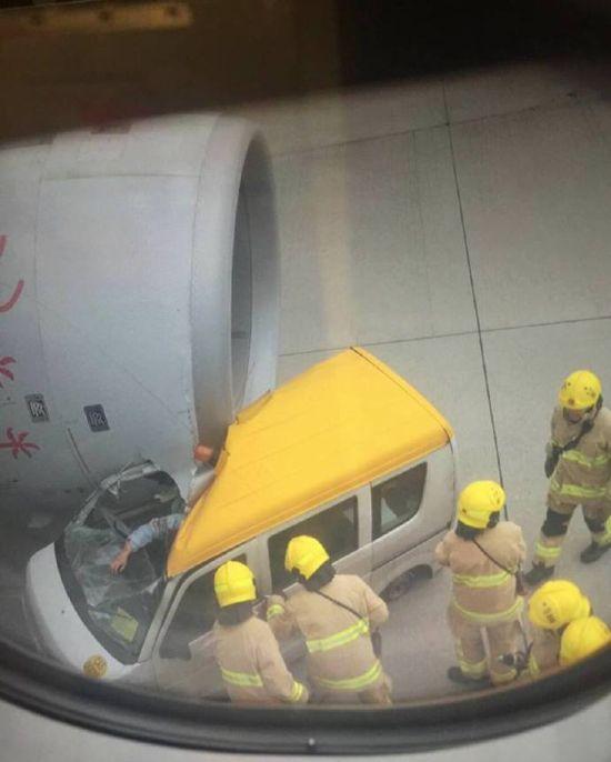 Hong Kong Plane Crushes Service Van On Airport Runway (4 pics)