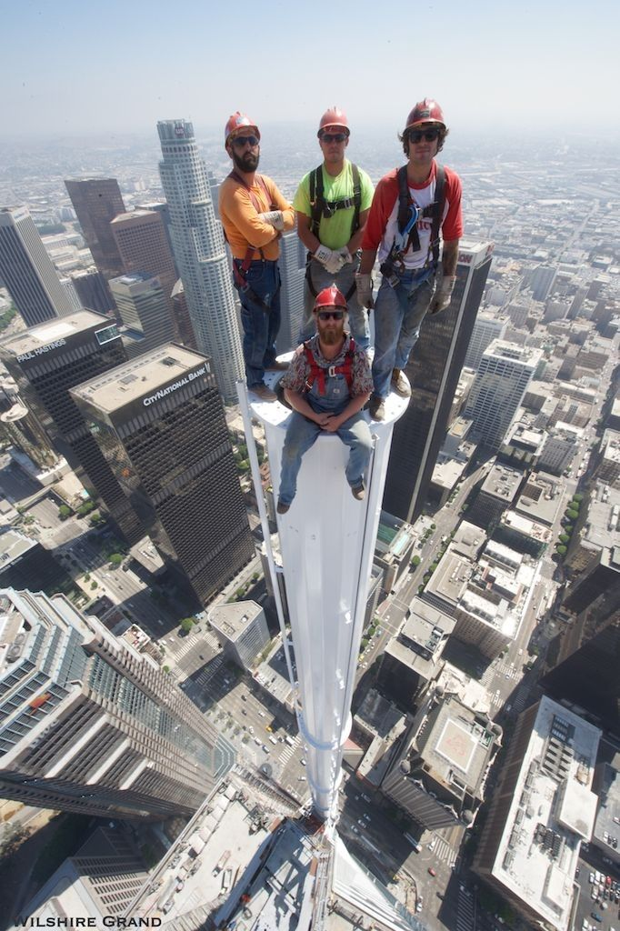 Workers Pose For A Dangerous Photo Atop The Wilshire Grand Center (2 pics)