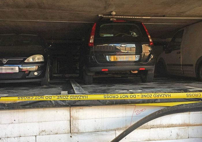 Cars Get Crushed After Pipe Bursts In Parking Garage (4 pics)