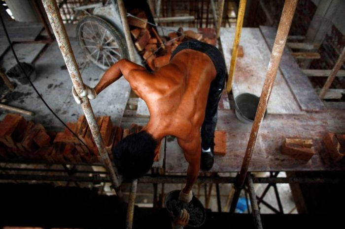 Handyman At Buddhist Temple Constantly Trains On The Job (18 pics)