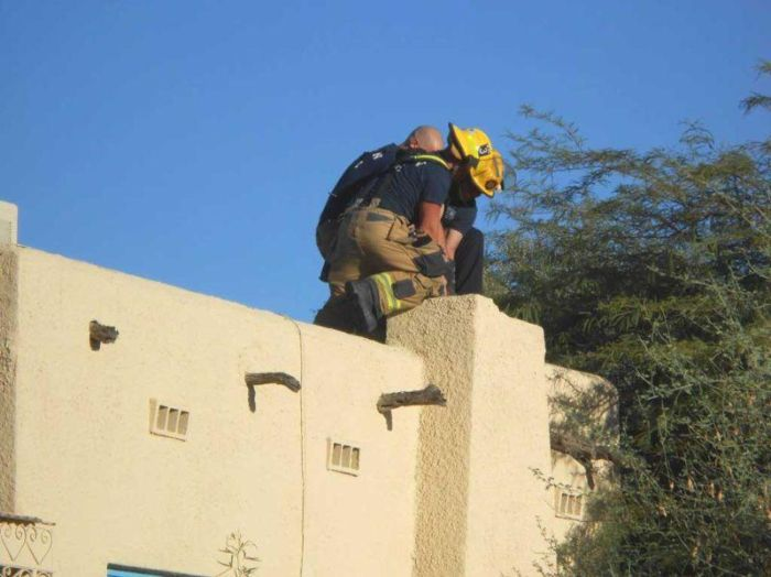 Guy Gets Pulled Out Of Chimney After Forgetting His Keys (4 pics)
