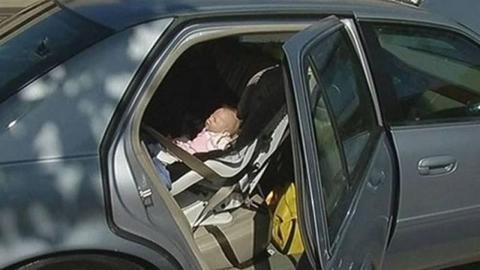 Cop Gets A Surprise When He Breaks Into A Car To Rescue A Baby (4 pics)