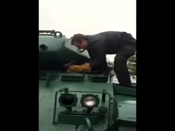 Raccoon Stuck In An Army Tank
