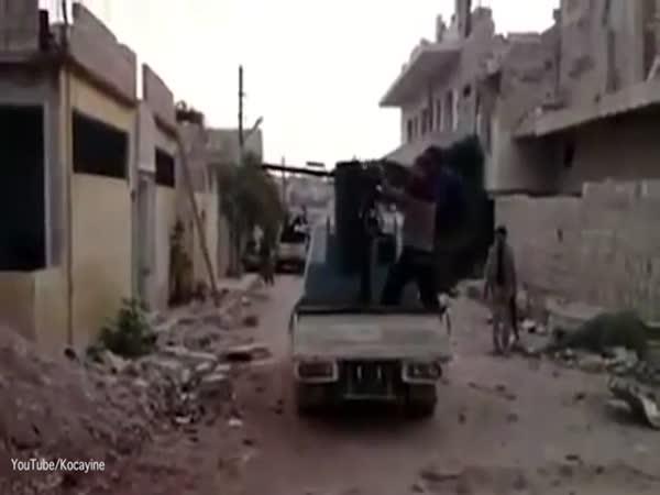 Jihadi Falls Off The Back Of An Armoured Vehicle