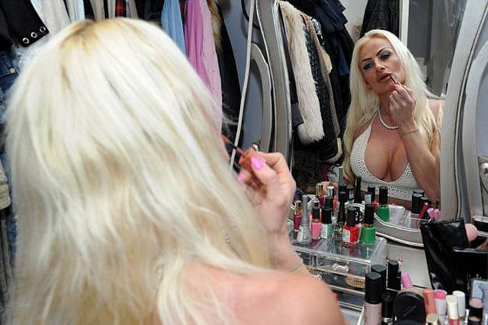 This Woman Spent Over $100,000 On Surgeries To Become A Plastic Barbie (13 pics)
