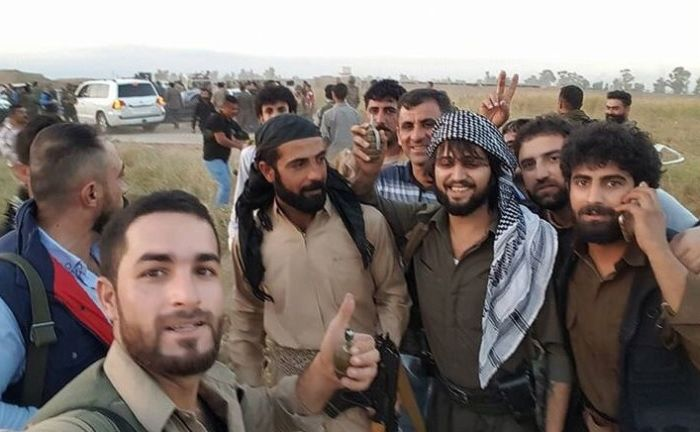 Man Rescues 70 People From ISIS Snipers Using Bulletproof BMW (4 pics)