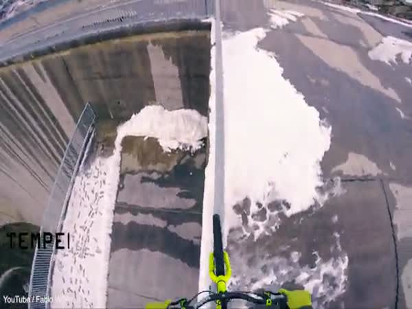 Daredevil Rides Along Narrow Barrier