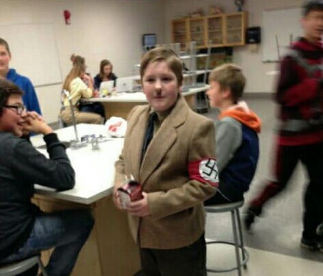 "Kid Wears Inappropriate Costume To ""Er"" Day (2 pics)"