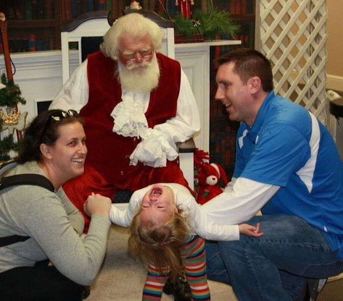 The Horrifying Reality Of Taking Your Kids To See Santa (27 pics)