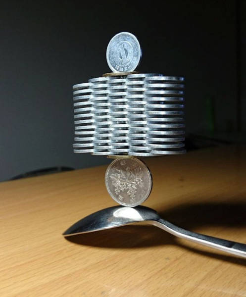 Japanese Guy Takes Coin Stacking To The Extreme (12 pics)