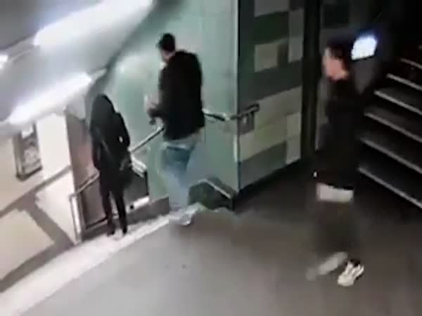 Horrifying Moment Woman Is Kicked Down The Stairs By Stranger in Berlin, Germany