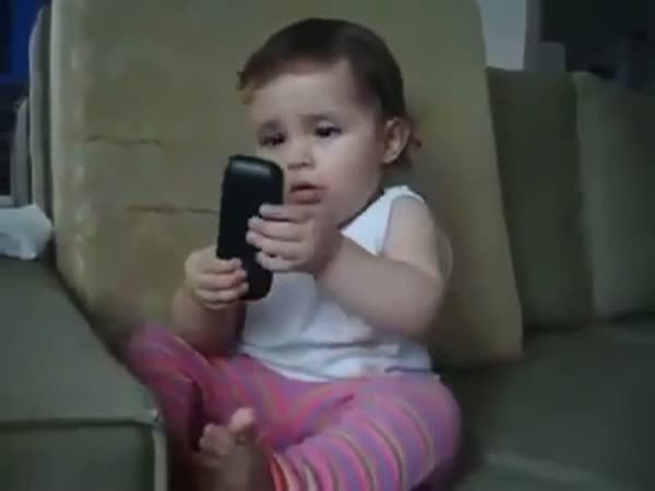 Baby Mocks Her Mom By Mimicking What She's Like On The Phone