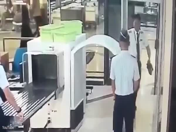 A Drunk Indonesian Pilot Stumbling Through Security