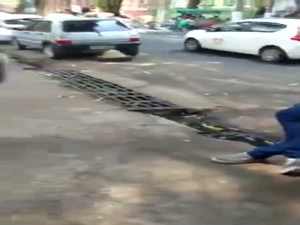 Beautiful Woman Dancing In The Street Takes Sewer Dive