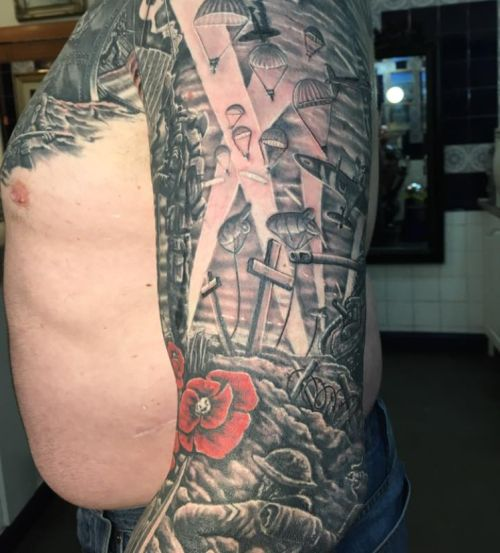 Guy Shows Off His Amazing World War II Cover Up Tattoo (8 pics)