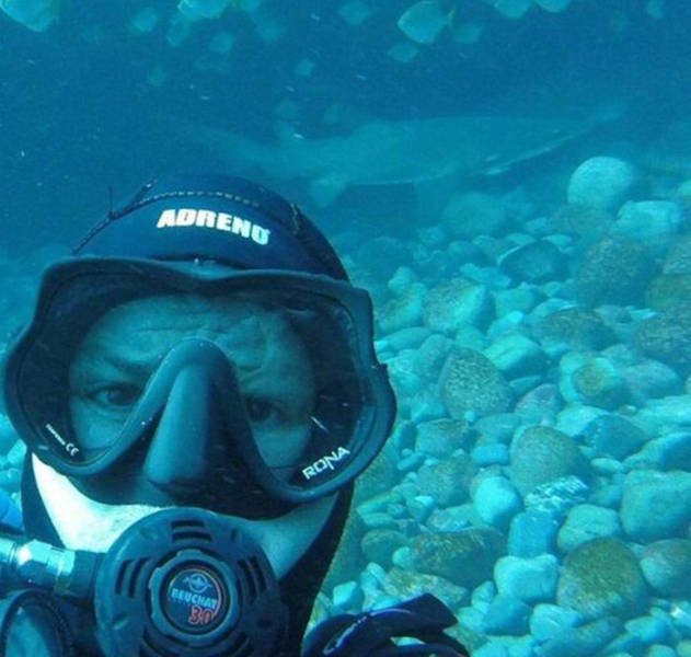 This Guy Just Loves To Play With Sharks (8 pics)