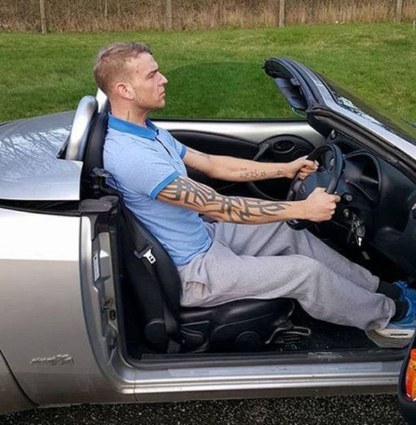 Tall Englishman Gets Busted For Driving While Standing (2 pics)