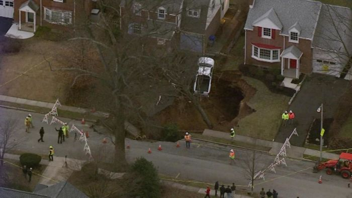 Large Sinkhole Swallows A Yard In Cheltenham (6 pics)