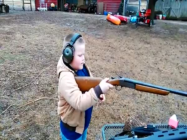 Kid Experiences The Kick After Shooting A Shot Gun