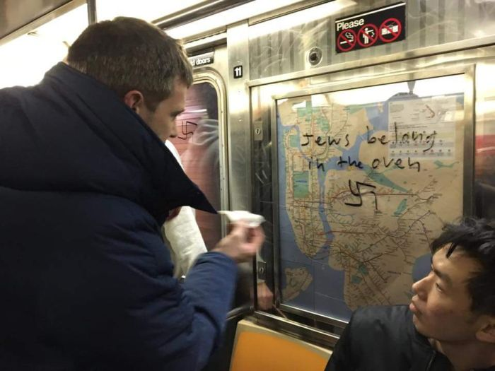 Passengers Clean Up Hateful Messages In New York City Subway Cars (5 pics)