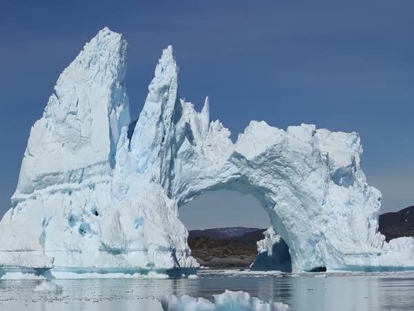 Tourists Watch An Iceberg Bridge Collapse In Greenland
