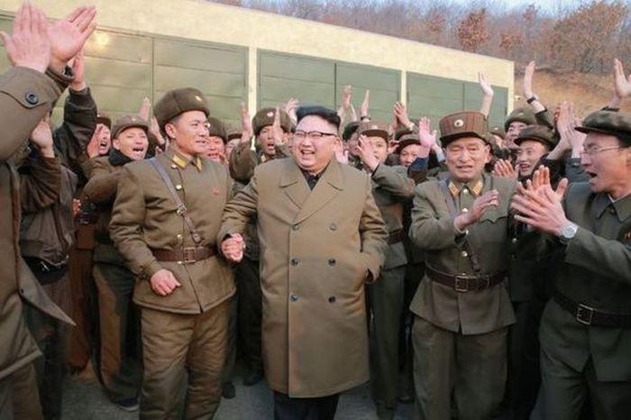 Kim Jong-Un Gives A Soldier A Piggyback Ride (4 pics)