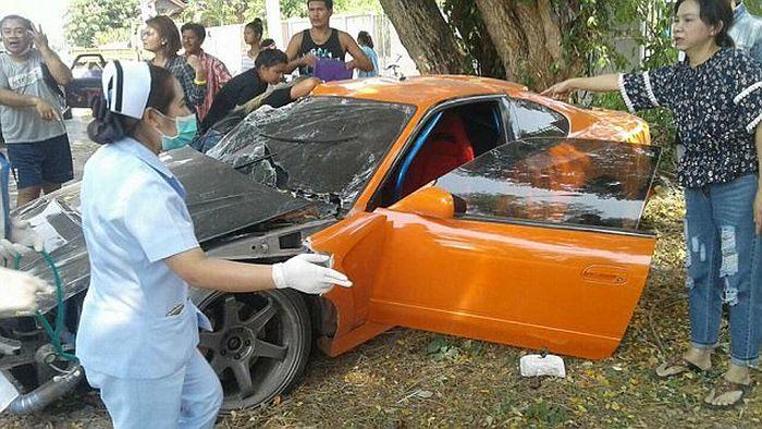 Buddhist Clergyman Wraps Sports Car Around A Tree (5 pics)