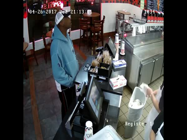 Calm Cashier Keeps His Cool As Armed Robber Threatens Him With Gun