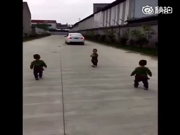 Heart Melting Triplets Toddle Behind Daddy's Car As He Leaves For Work