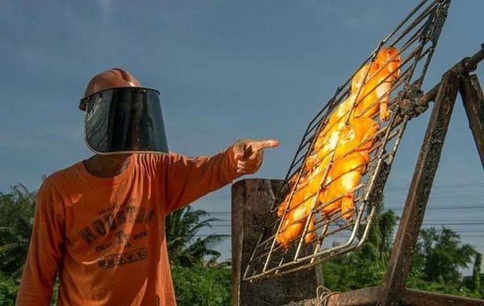 Thailand Man Uses The Power Of The Sun To Cook Chicken (4 pics)