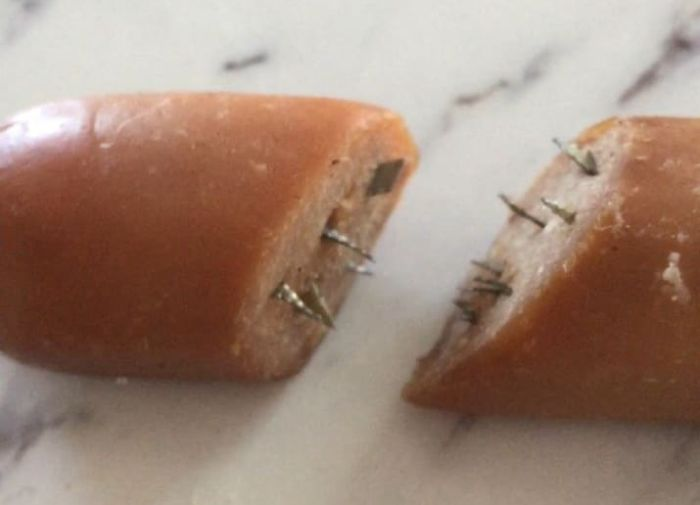 Dog Owner Finds Hot Dogs With Razor Shards In Their Yard (3 pics)