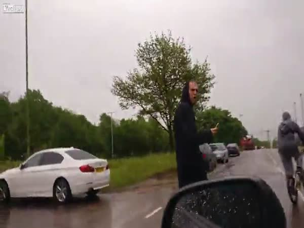 Guy Hits Drivers Car With Bottle And Gets Dealt With