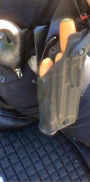 Police Officer Carries Something Special In Her Holster (2 pics)