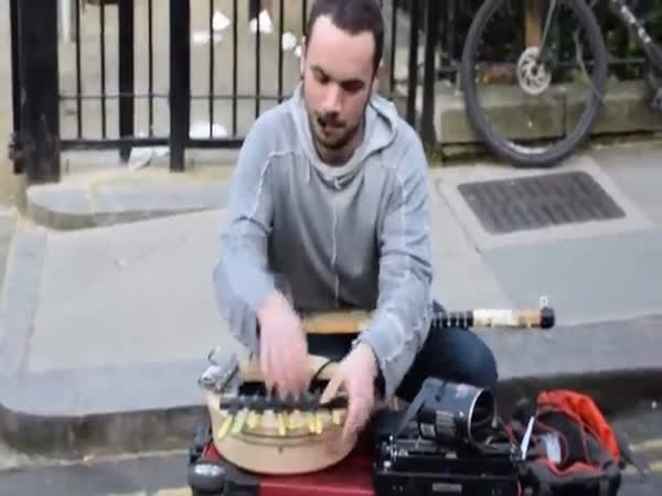 Street Musician Playing On A Tennis Racket