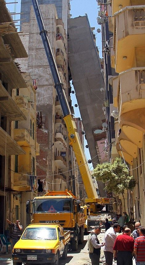 High Rise Building Falls Into A House In Egypt (6 pics)