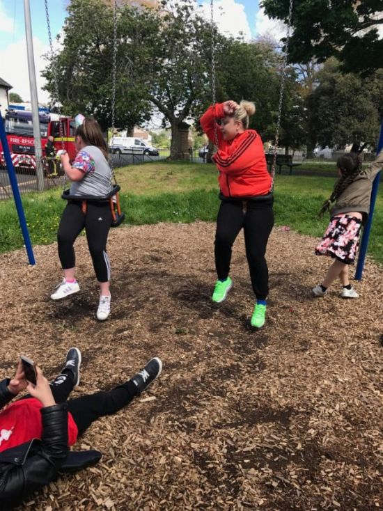 Aunt And Niece Get Stuck In Children's Swing (4 pics)