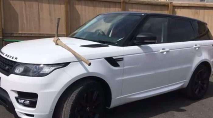 Disgruntled Employee Takes A Pickaxe To Boss' Range Rover (2 pics)