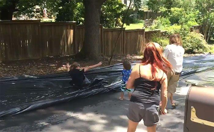 Police Slide Down Illegal Slip 'N Slide Instead Of Shutting It Down (6 pics)