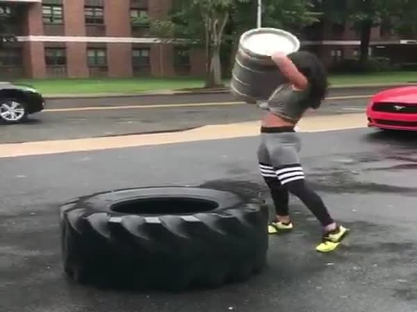 Girl Works Out With a Huge Tire