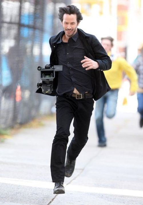 Keanu Reeves Runs Away With Stolen Paparazzi Camera (4 pics)