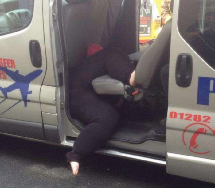 Firefighters Rescue Woman Stuck In A Taxi (2 pics)