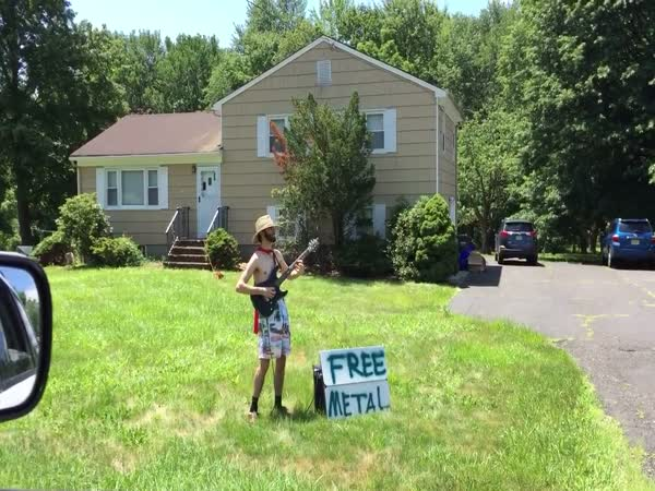 Guy With a Guitar And a Sign That Says 'Free Metal' Delivers On That Promise