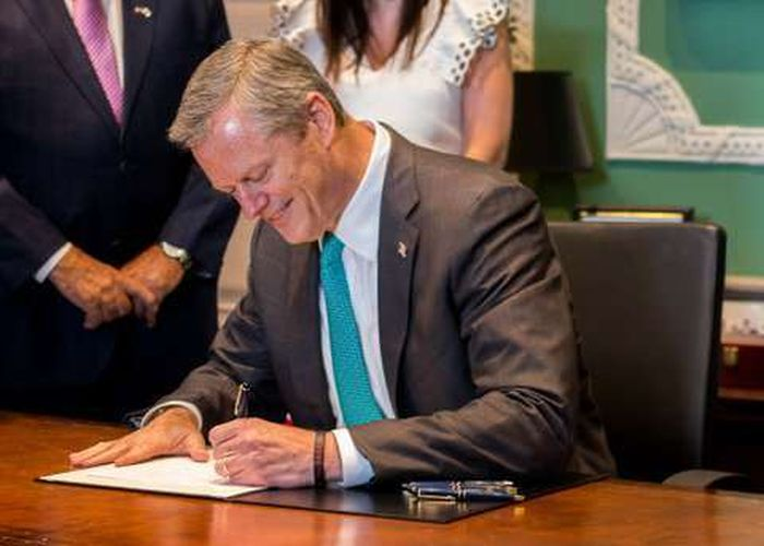 The Governor Of Massachusetts Smiles As He Signs Off On New Law (3 pics)