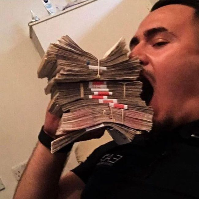 Albanian Crooks Show Off Their Money By Flaunting Stacks Of Cash (4 pics)